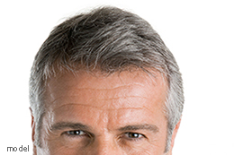 Gray-haired man's wrinkled brow