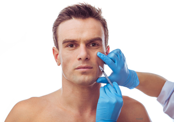 male patient receiving injectables. Just one of many facial options