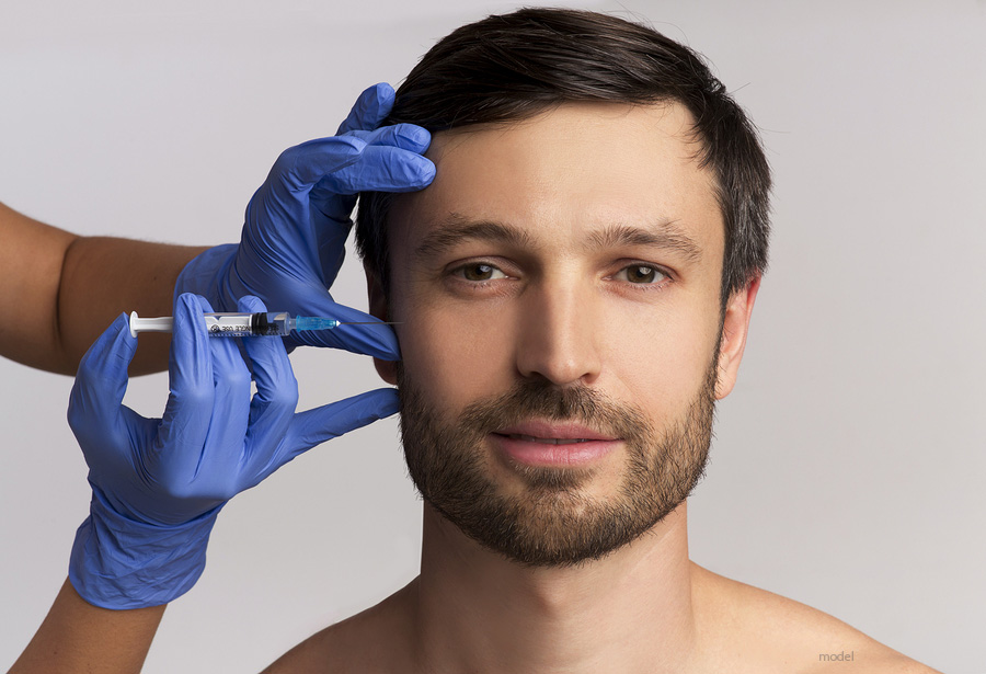 image of male patient receiving injection of dermal fillers into his face