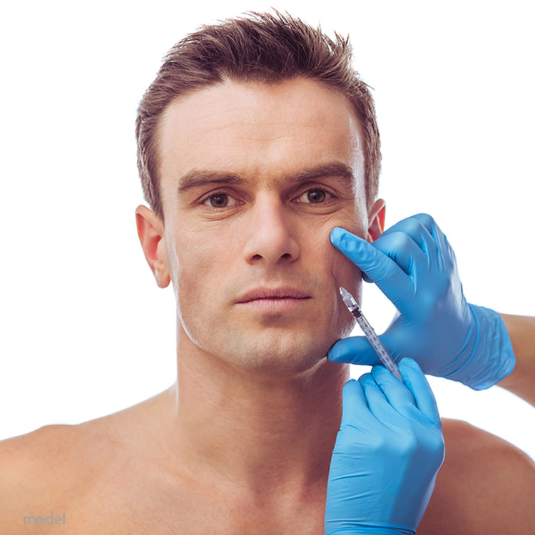 Man receiving injectable dermal filler into his cheek. Image demonstrates fillers and neuromodulators available at Chicago's Iteld Plastic Surgery