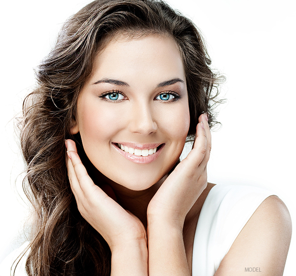 Young happy woman with clear skin, demonstrating enhanced skin care available at Chicago's Iteld Plastic Surgery
